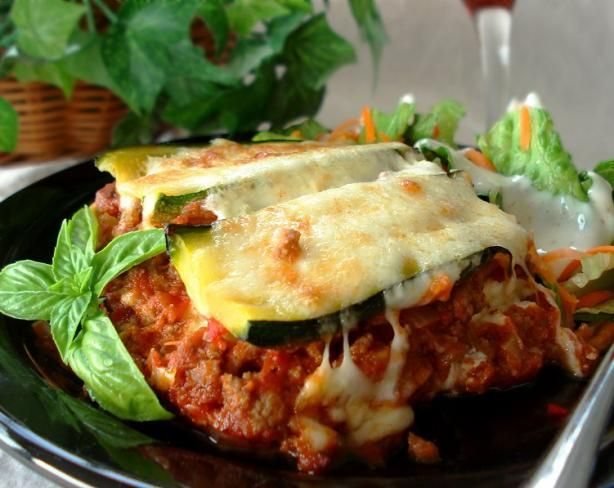 Zucchini Lasagna - Really tasty after some modifications. Doubled the meat, doubled the spices, added an extra zucchini or two. Used Prego tomato basil sauce instead of paste and diced tomato. Boiled the zucchini until almost tender, make sure to drain off as much water as you can. Layer it up, extra cheese of course! Really delish! Will make next time my sister is here (gluten-free diet)!