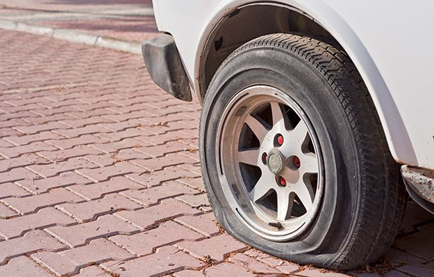 An emergency flat tire kit and other things you should definitely carry around in your vehicle.
