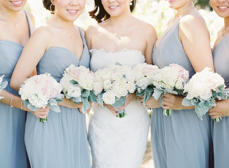 Blue Bridesmaids with Ivory Bouquets   photography by http://thegreatromancephoto.com/