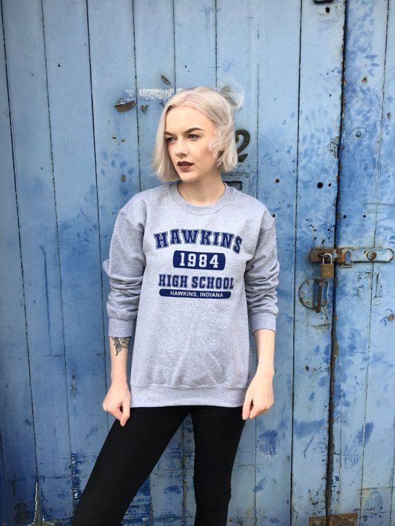 *** SPECIAL OFFER *** Buy any 2+ items and receive 15% off! Just enter this code in the checkout: ASO15  Hawkins High is a varsity style design inspired by the cult Netflix tv show Stranger Things  The design has been screen printed locally with eco-friendly water based inks onto a