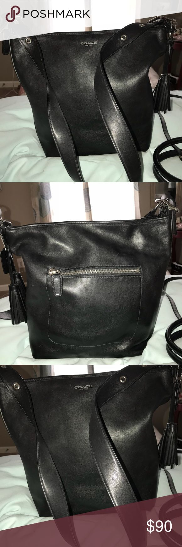 "Coach Legacy large Leather Shoulder Bag Coach Legacy Black Leather Duffle Shoulder Bag Convert Crossbody. This bag is in excellent condition with a tiny bit of wear. It feels like butter in your hands!!!  Quantity: 1 available Brand: Coach Bag Height: 13"" Approx Style: Hobo Bucket Duffel Handbag Crossbody Shoulder Bag Bag Depth: 5"" Approx Material: Leather Coach Bags Shoulder Bags"