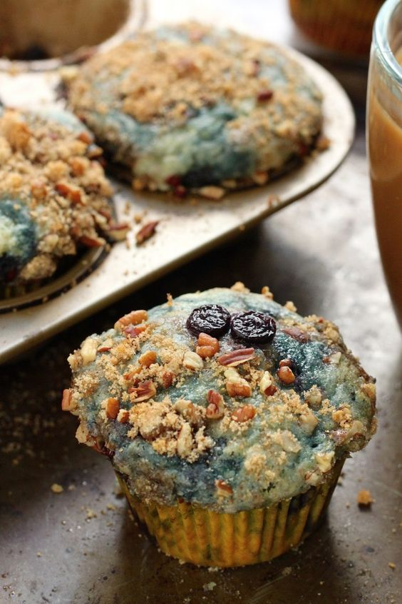 Greek Yogurt Blueberry Crumble Muffins - These blueberry bursting soft and fluffy muffins are sure to be a new breakfast favorite!