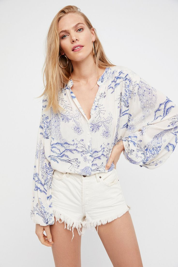 Metallic Blooms Printed Top | Semi-sheer printed tunic with button closures down the front.    * Oversized silhouette   * Wide billowy dolman sleeves   * Elastic cuffs    **Styling Tip:** This versatile top can also be worn as a super mini dress. For a no-show look layer with one of our seamless shorts for an effortless look.