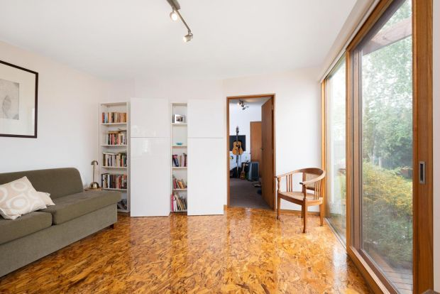 This isn't technically a wooden floor but rather an engineered wood-based panel consisting of strands of wood which are bonded together with a synthetic resin. OSB (oriented strand board) has been used as a floor on this project in Northcote, Victoria, Australia, by Statkus Architecture. The floor was then sealed with a clear gloss varnish. A sheet of 18mm OSB board costs €22 from Chadwicks.statarch.com.au chadwicks.ie