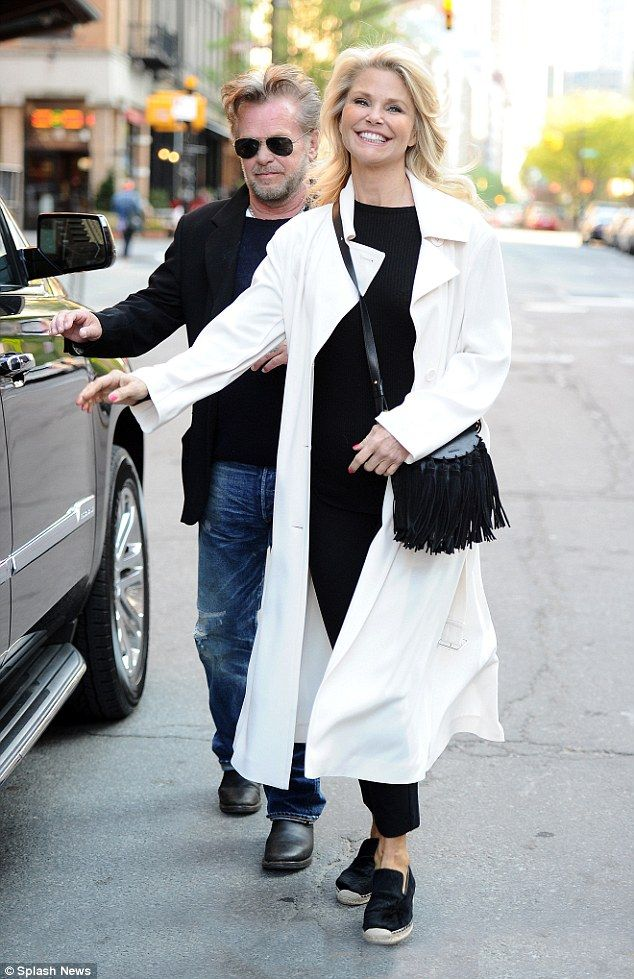 Happy! Christie Brinkley, 62, was grinning like the Cheshire Cat when she stepped out hand in hand with John Mellencamp, 64, in New York on Sunday