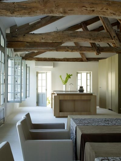 Love the Mountain Modern approach to design.  THe beams the wood the furniture.  Clean & Green, orangerie montmoreau