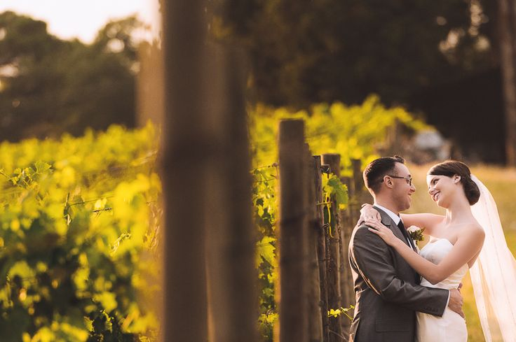 Wedding Photography in Chianti shire at Villa Nozzole. Lovely portrait of the bride and groom near a wineyard. Photo by Gabriele Fani Photographer.