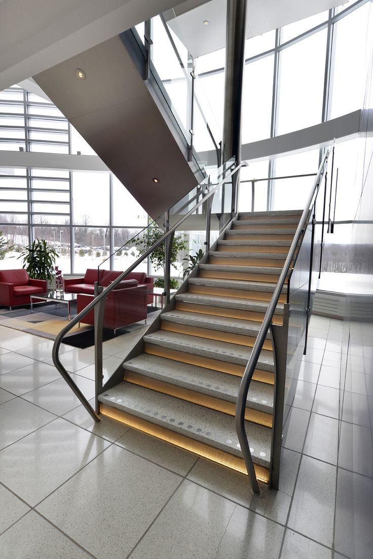 "Mediacom Offices, Monroe, New York   Mediacom the 8th media agency in the U.S. providing cable TV services, chose an #Interbau #madeinitaly #design stairway for its futuristic premises in collaboration with the American reseller Michael Williams of ""da Vinci by design"": the stairway develops around a central stainless-steel 12m pillar that goes from the ground floor up to the ceiling."