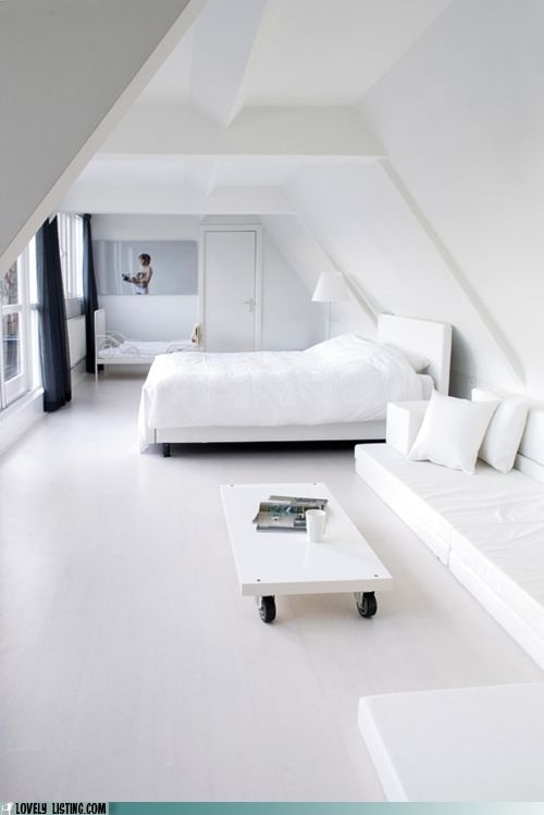 all white room with white table on castors