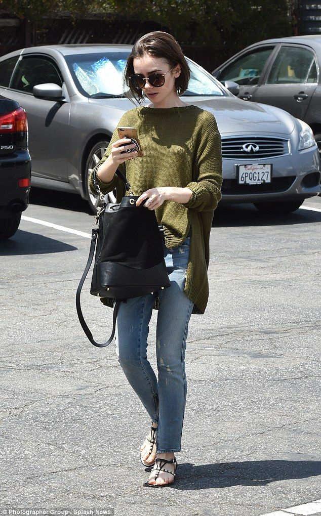 Out and about: Lily Collins didn't disappoint as she stepped out in a cosy jumper for a da...
