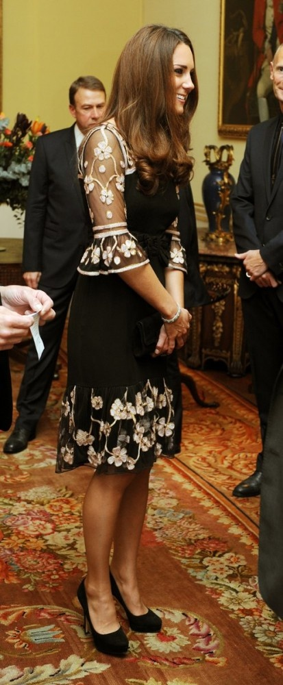 October 23, 2012: Kate Middleton attends a reception for Team GB Olympic and Paralympic medalists at Buckingham Palace. She's wearing a custom Alice by Temperley dress, black suede Jimmy Choo pumps and a diamond bracelet.