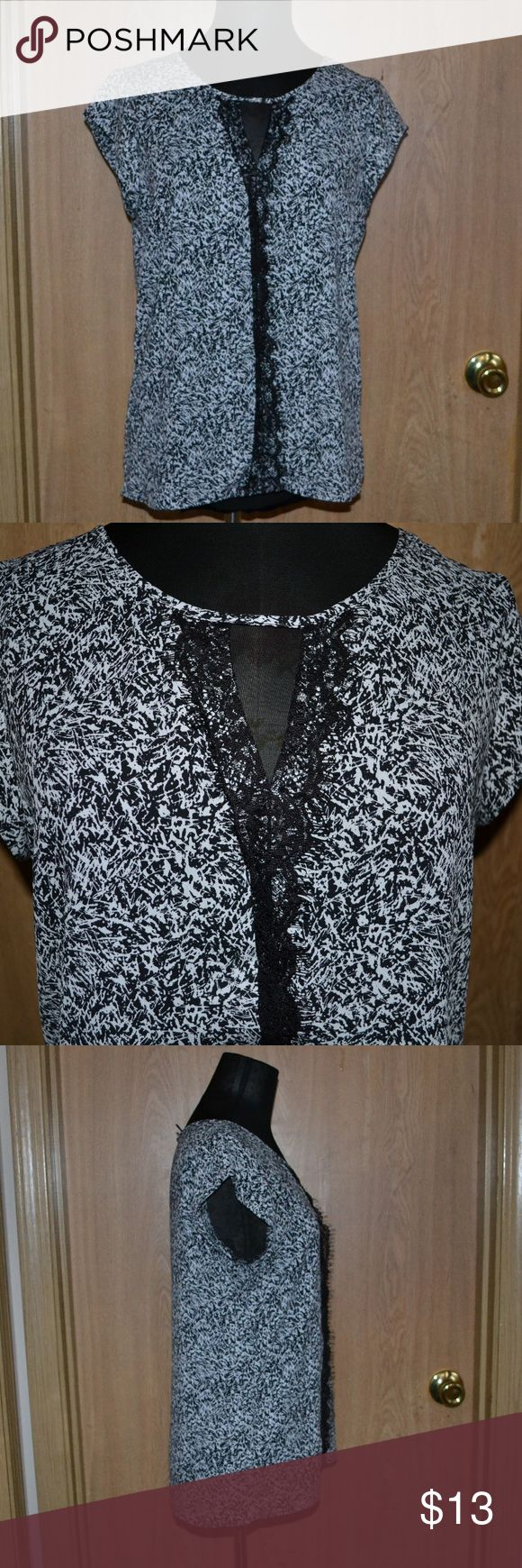 Express white & black lace short sleeved blouse THIS ITEM IS NOT INCLUDED IN THE 5 FOR 25 SALE! I ship Monday- Friday (sometimes Saturday!) Smoke free home.   A beautiful short sleeved black & white top with black slace down the middle size small 100% polyester. in excellent condition perfect for work. Express Tops Tees - Short Sleeve
