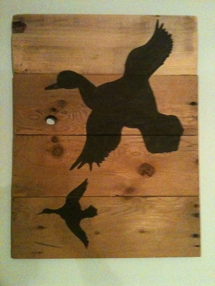 Hand painted silhouette wood ducks on rustic  Wood.  Size is  22 x 17 $ 60.00
