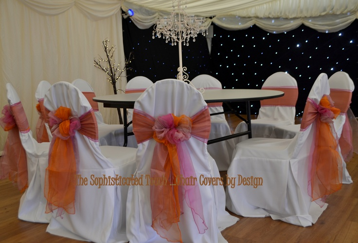 Pink, Peach and Orange Organza Triple Bows on White Chair Covers The Sophisticated Touch ...Chair Covers by Design