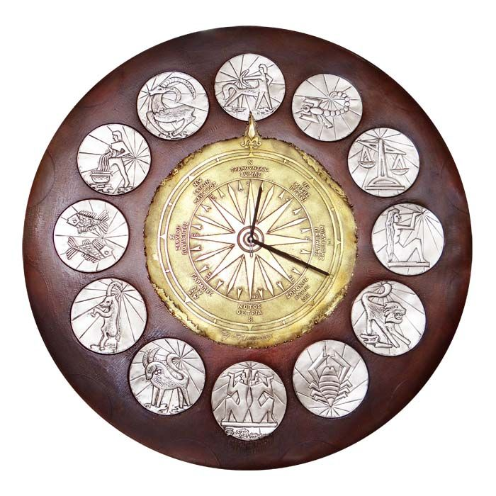 We created an impressive round copper wall clock, with engraved depictions of all the zodiac signs and a windrose, with the names of the winds and the four points of the horizon. Diameter: 75cm Copper with partial silver-plating and bronze-plating.
