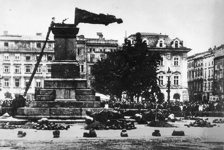 The destruction of the Adam Mickiewicz Monument in the city of Kraków, Poland by German forces on August 17, 1940. Pin by Paolo Marzioli