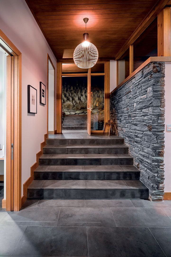The material palette of timber and stone features inside also, lending cohesion tot he internal and external spaces.