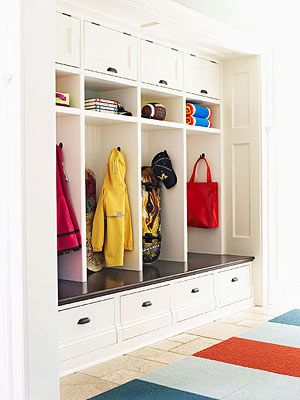 A wall of cubbies makes for great storage in a mudroom.