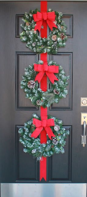 Front door Christmas Decorations but I would do each wreath different same color…