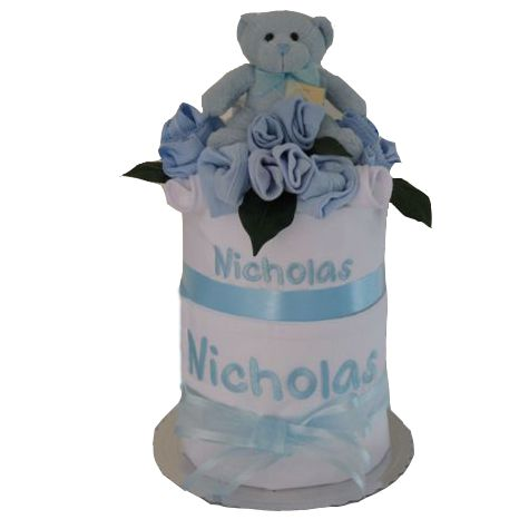 Personalised cot sheet nappy cake.