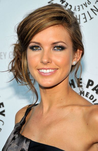 Audrina Patridge Loose Bun  Audrina's messy side-bun shows off her colorful neck tattoo.