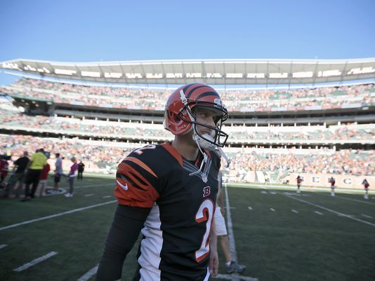 Bengals execute last-second FG perfectly. Photo: Cincinnati Bengals kicker Mike Nugent (2) heads for the locker room after kicking the game-winning field goal in overtime of the NFL Week 5 game between the Cincinnati Bengals and the Seattle Seahawks at Paul Brown Stadium in Cincinnati, on Sunday, Oct. 11, 2015. The Bengals advanced to 5-0 with a 27-24 overtime win over Seattle. The Enquirer/Sam Greene