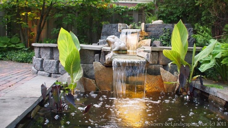 modern fish pond design with waterfall and sculpture ornament