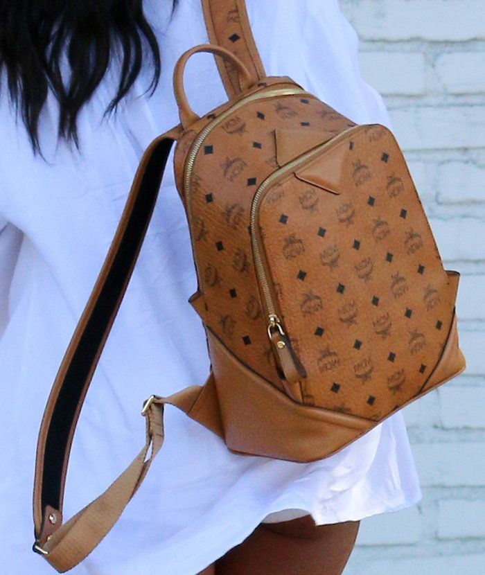 Karrueche Tran in Flirty Summer Getup with MCM Backpack