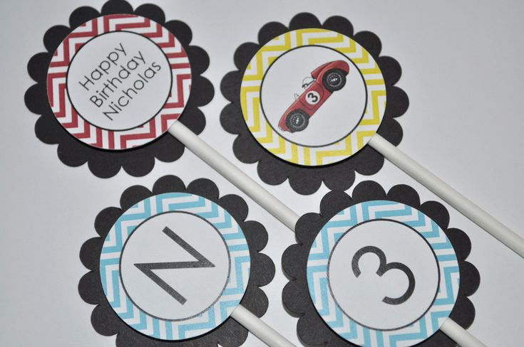 12 Boys Birthday Cupcake Toppers - Chevron Birthday Decorations, Race Car Birthday Party Decorations in Blue, Red, Yellow & Black. $10.00, via Etsy.