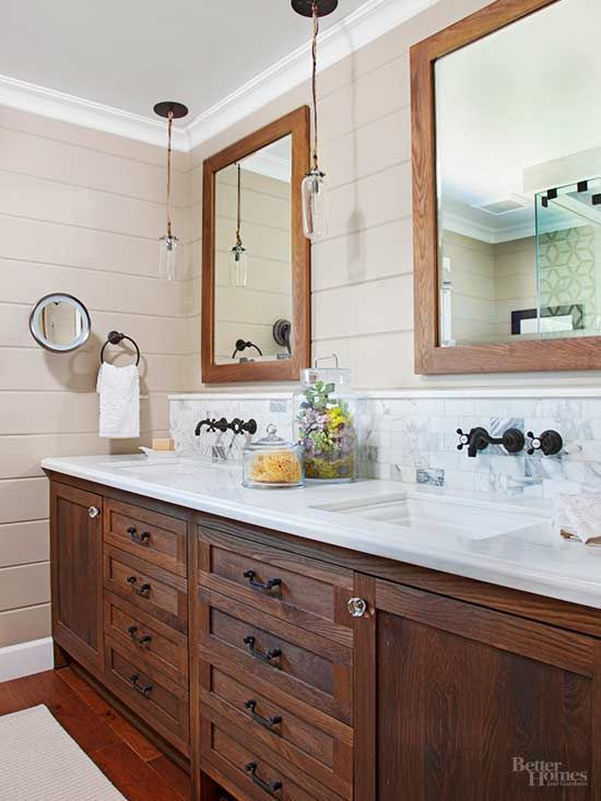 Upgraded features in the master bath include shiplap siding and new lights. Initially, the couple wanted to do just a few small projects, but after Sneed smoothed the bath's textured ceiling and installed pendants with 4-inch LED bulbs, they adjusted their budget to expand remodeling efforts to the rest of the house/