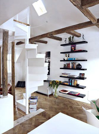 Contrast of oak beams with pure white walls and spiral staircase