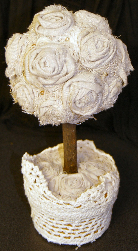 Rosette topiary rose wedding decor by