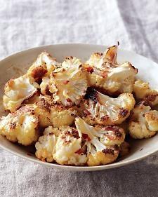 SO YUMMY! 1/2 head cauliflower, 1 T. olive oil, sea salt, red chile flakes.  Roast 20 min in 400 degree oven.
