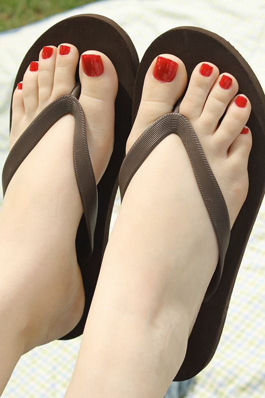 Theme simply Black women feet in flip flops toenails agree with