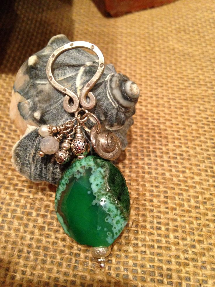 I AM ~ Green Goddess . ~  Green is the color of the heart chakra, this is about love (of others and self) and the unity with all life energies.  Green agate is a unique and  magical stone combining the elements of (EARTH) a energy that facilitates one to stand strong and take root in ones true core beliefs (WATER) Fluidity~ a force that's flexible yet mighty as it has the strength to move mountains by means of sheer perseverance  ( AIR ) a element that brings clarity.~ ALLISON 2/27/2015