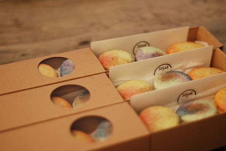 Handpainted Saffron-Orange Blossom macarons on Orange-Pistachio shells, Moroccan Spiced Coffee macarons, and Lemongrass-Coconut macarons, all packed up and ready to go.