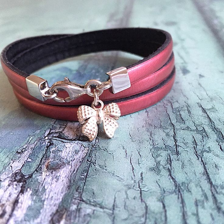 Sterling silver bow bracelet in metallic berry leather. A new addition in my shop. Check out the metallic collection. There are seven colours leather available. Women's jewellery.