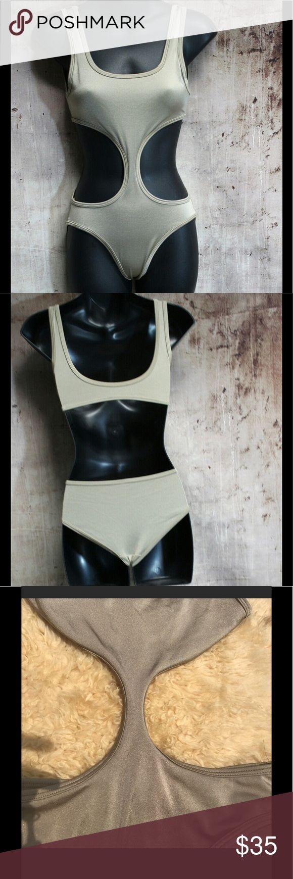 AA light gold cut out swimsuit Brand new never worn . With out tags . Size small. Super gorgeous Light nude shimmer gold color. American Apparel Swim One Pieces