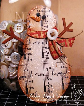 snowman, made with chipboard and sheet music