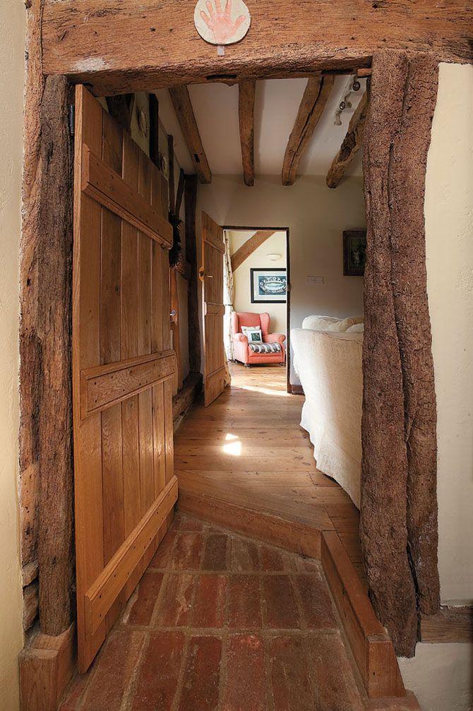 Living edge door frames; brick and wooden floors