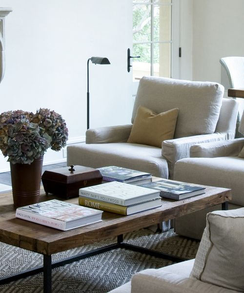 Love this thick top raw wood coffee table with iron base!
