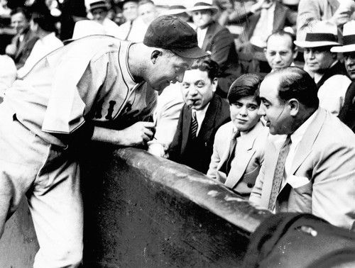 As his power and wealth increased, Al Capone became a Chicago celebrity. Here he enjoys a front-row seat -- and a visit with the Cubs' Gabby Hartnett -- at a Wrigley Field charity game. Seated to Capone's right, smoking a cigar, is Roland Libonati, a state representative.