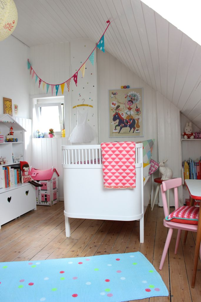 Love this bright modern girl's nursery!  The retro crib and pennant banner are beautiful!