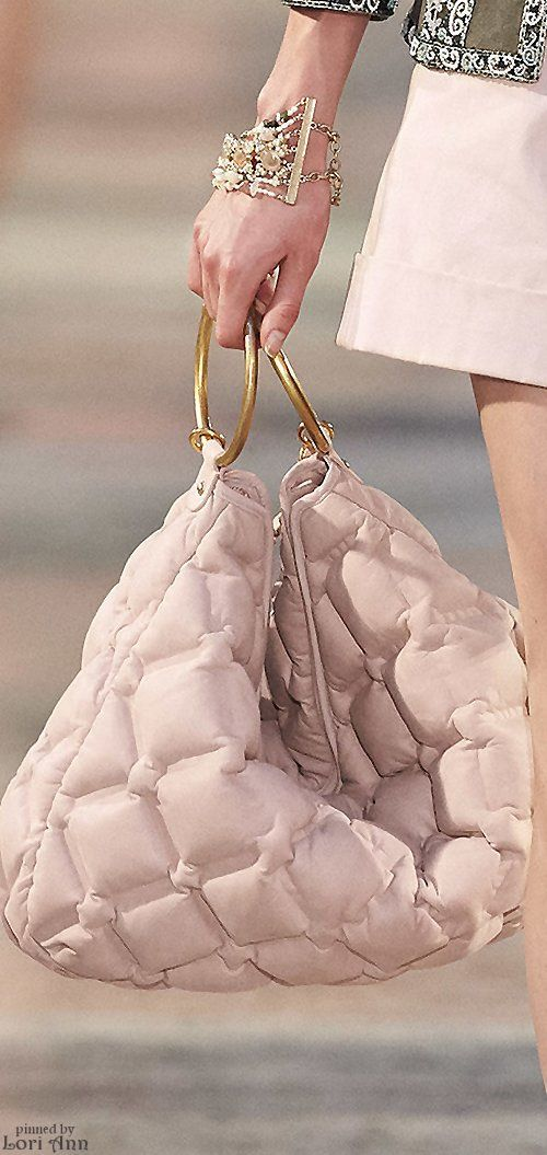 06.03.16 love the material of the handbag and the statement of the big D-rings. Chanel Resort 2017