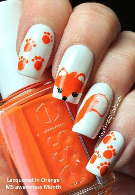 This is a super cute idea. I would probably skip the paw prints, and just do those nails in a matte orange