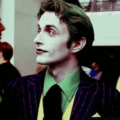 Click through for the full-on grin, he's got it down pat. The best Joker cosplay ever. Period. I wish to marry this man