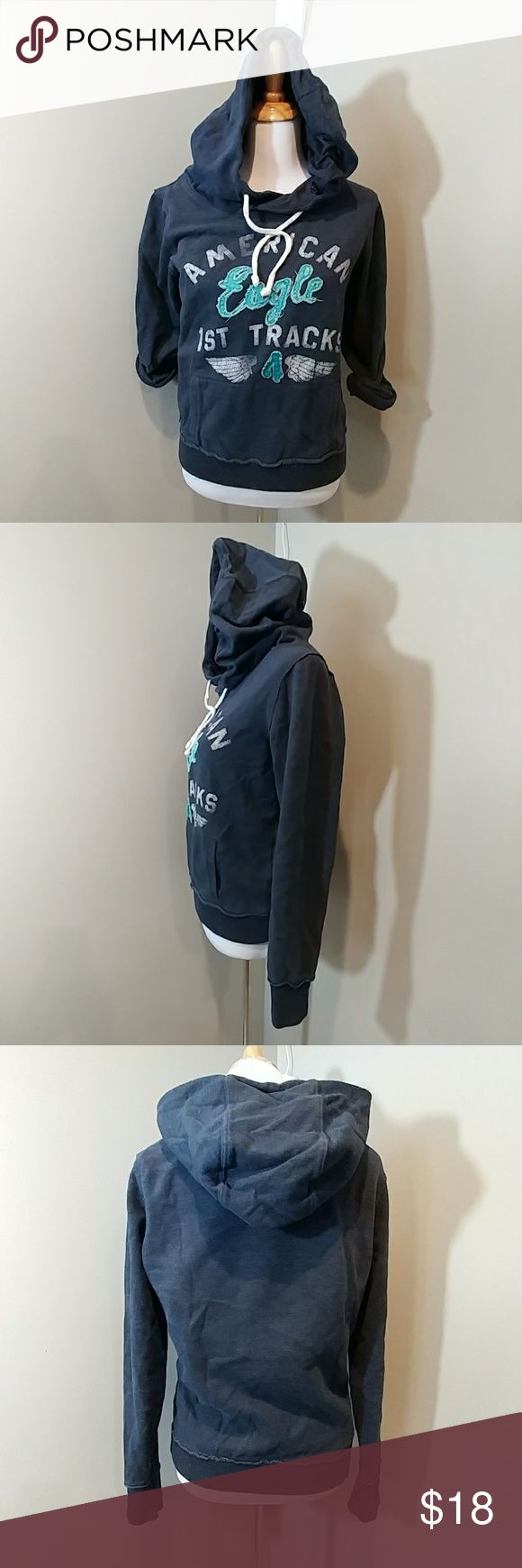 American Eagle Outfitters Juniors Graphic Hoodie Pre-Owned in Excellent Condition! The Front is designed to look vintage.  Pocket in the front to warm your hands.  Pull string for hood Size Medium  Cotton Blend American Eagle Outfitters Tops Sweatshirts & Hoodies