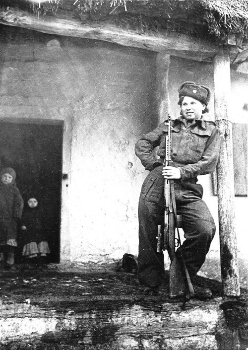 Soviet sniper Valentine Binevska with her SVT-40 rifle, equipped with a telescopic sight, 1942