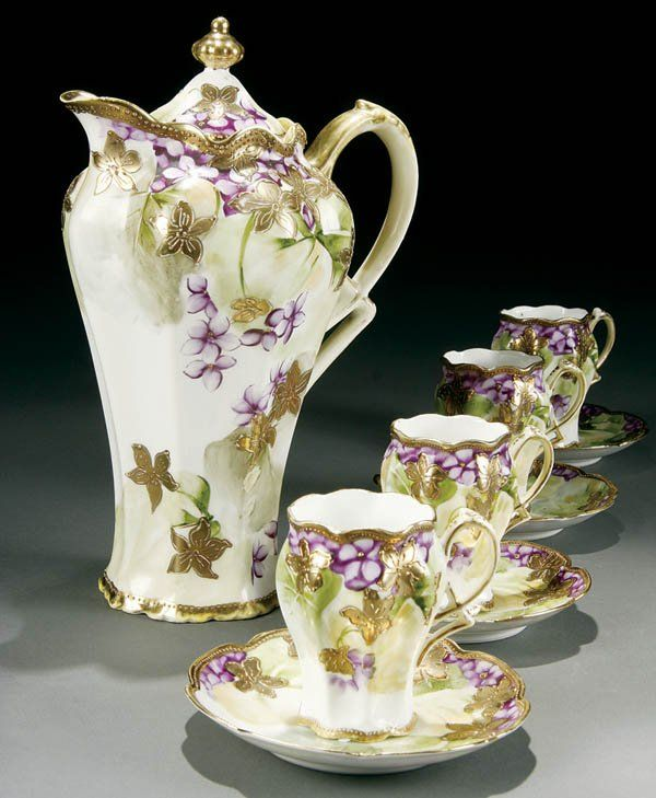 A 9-PIECE HAND PAINTED NIPPON CHOCOLATE SET early 20th century