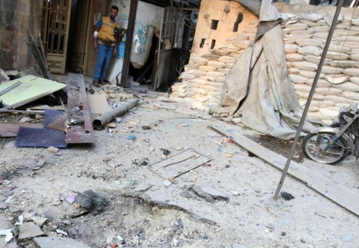 Russian or Syrian warplanes knocked two hospitals out of service in the besieged rebel sector of Aleppo on Wednesday and ground forces intensified an assault in a battle which the United Nations said had made the city worse than a slaughterhouse.